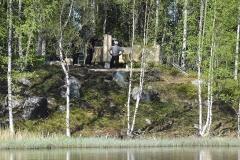 Byggplatsen sedd över sjön